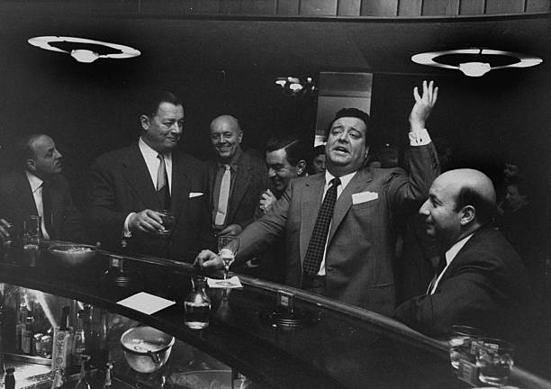 "Restaurateur Toots Shor with actor and comedian Jackie Gleason at Shor's infamous ""round bar"""