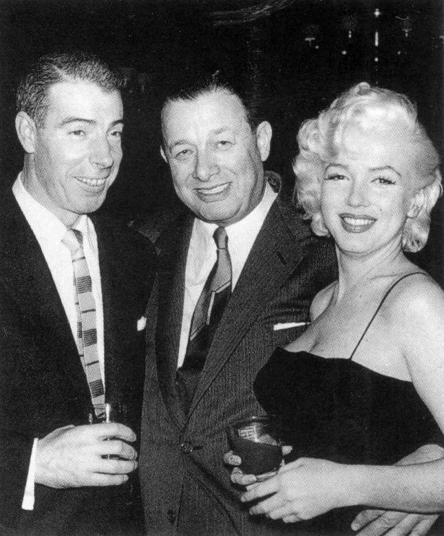 Joe DiMaggio, Toots Shor, and Marilyn Monroe attending Jackie Gleason's birthday party at Toots Shor's Restaurant, February 26, 1955