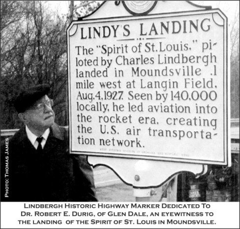 An eyewitness to the landing stands next to the marker representing the location. (Photo courtesy of Thomas James)