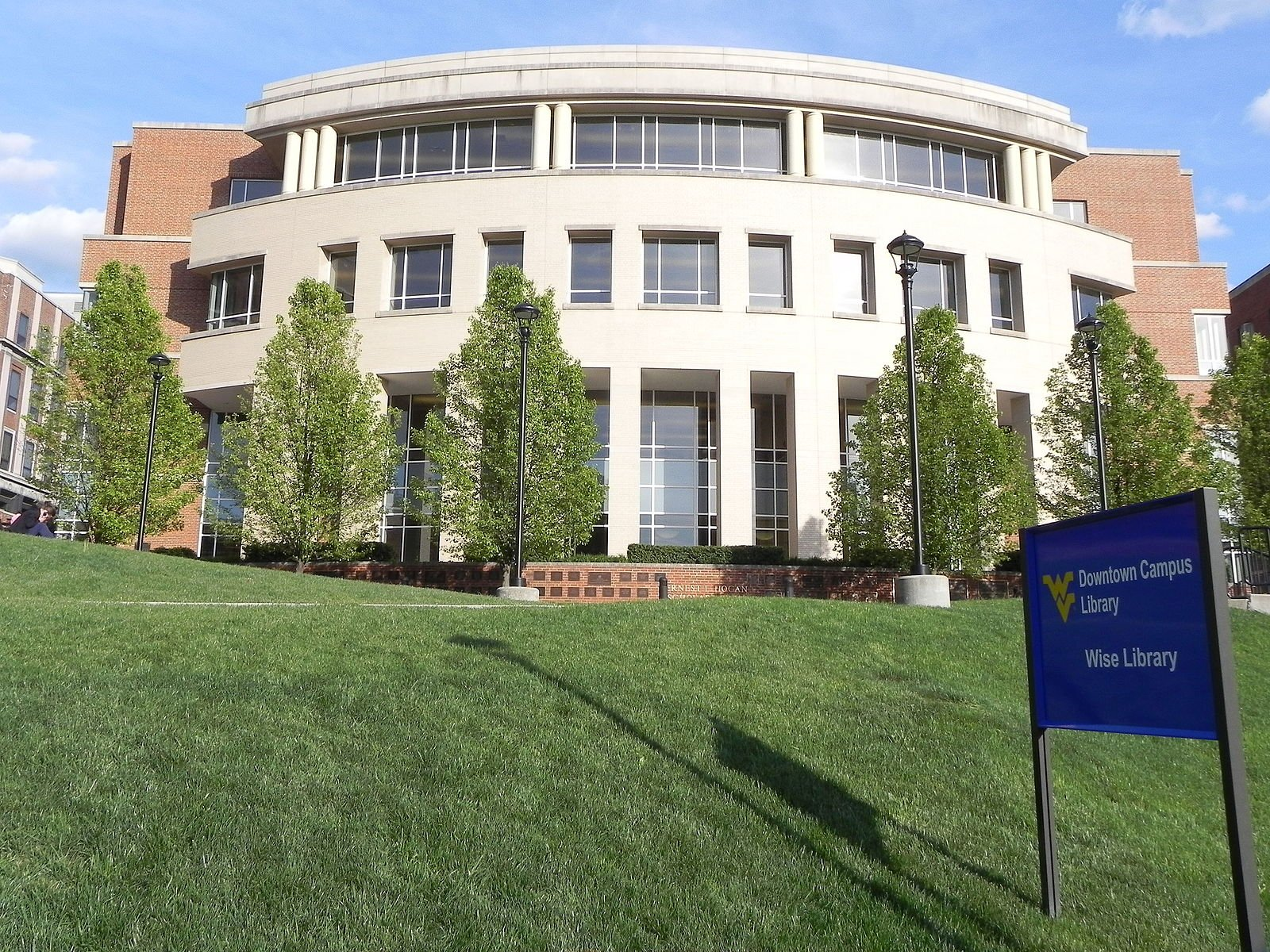 The modern library on the Downtown campus at WVU is built onto the front of the old Wise Library. Wikimedia Commons.