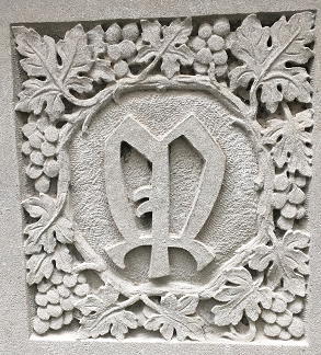 Seal of the Mortley Press, Ltd., London, England, with the design representing the rich borders and bookplates of this house. Located in the atrium at the front entrance to Wise Library.