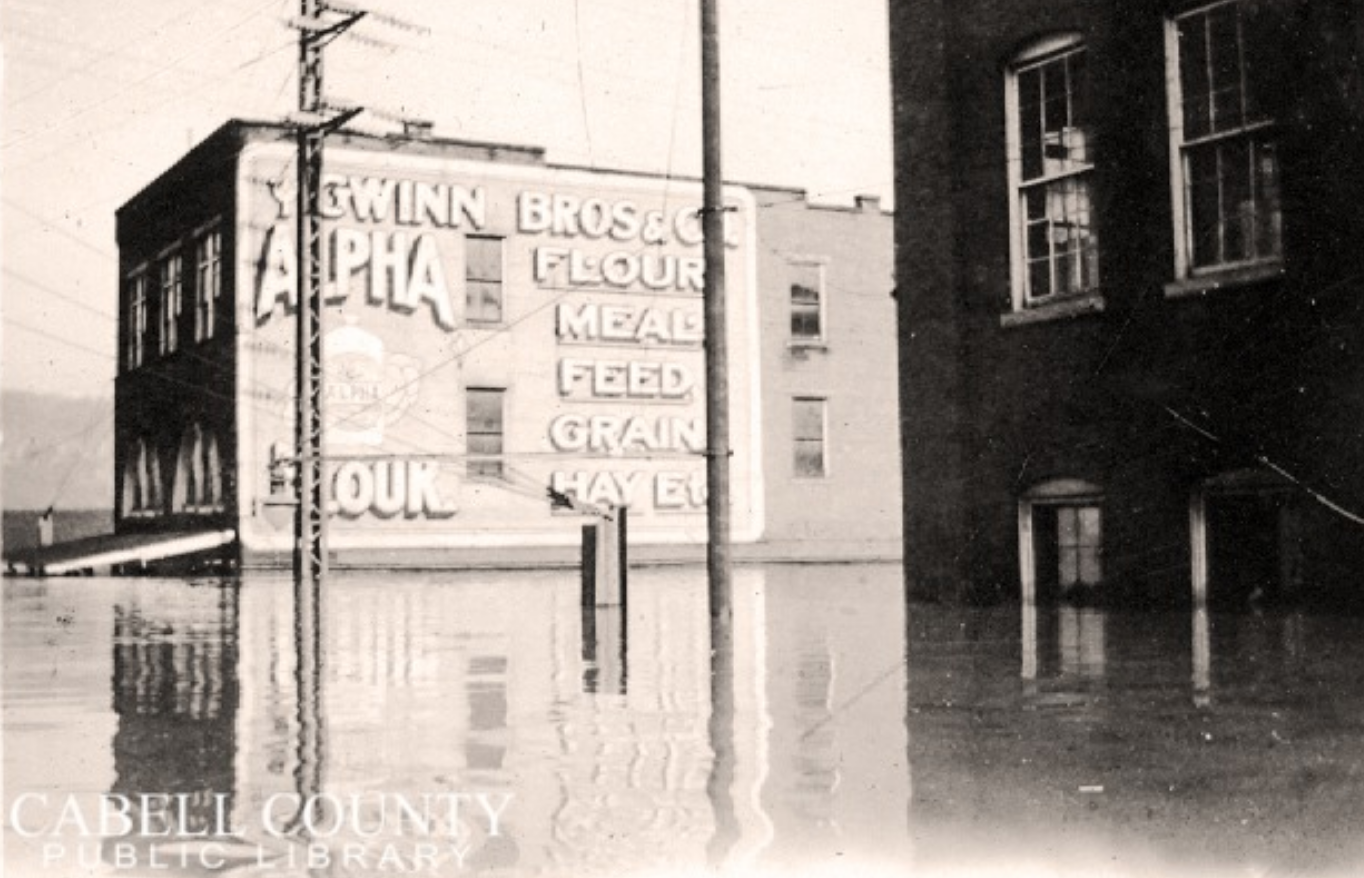 A building advertising Gwinn Bros. Mill during the 1937 flood