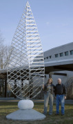 Artist Johnathan Cox beside the Arts Center's first permanent outdoor sculpture, The Discovery IV.