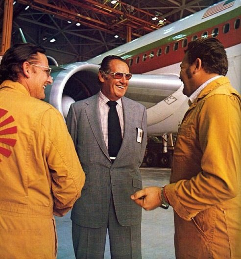 Robert F. Six, seen with Continental maintenance workers, served as president and chief executive office for over 40 years