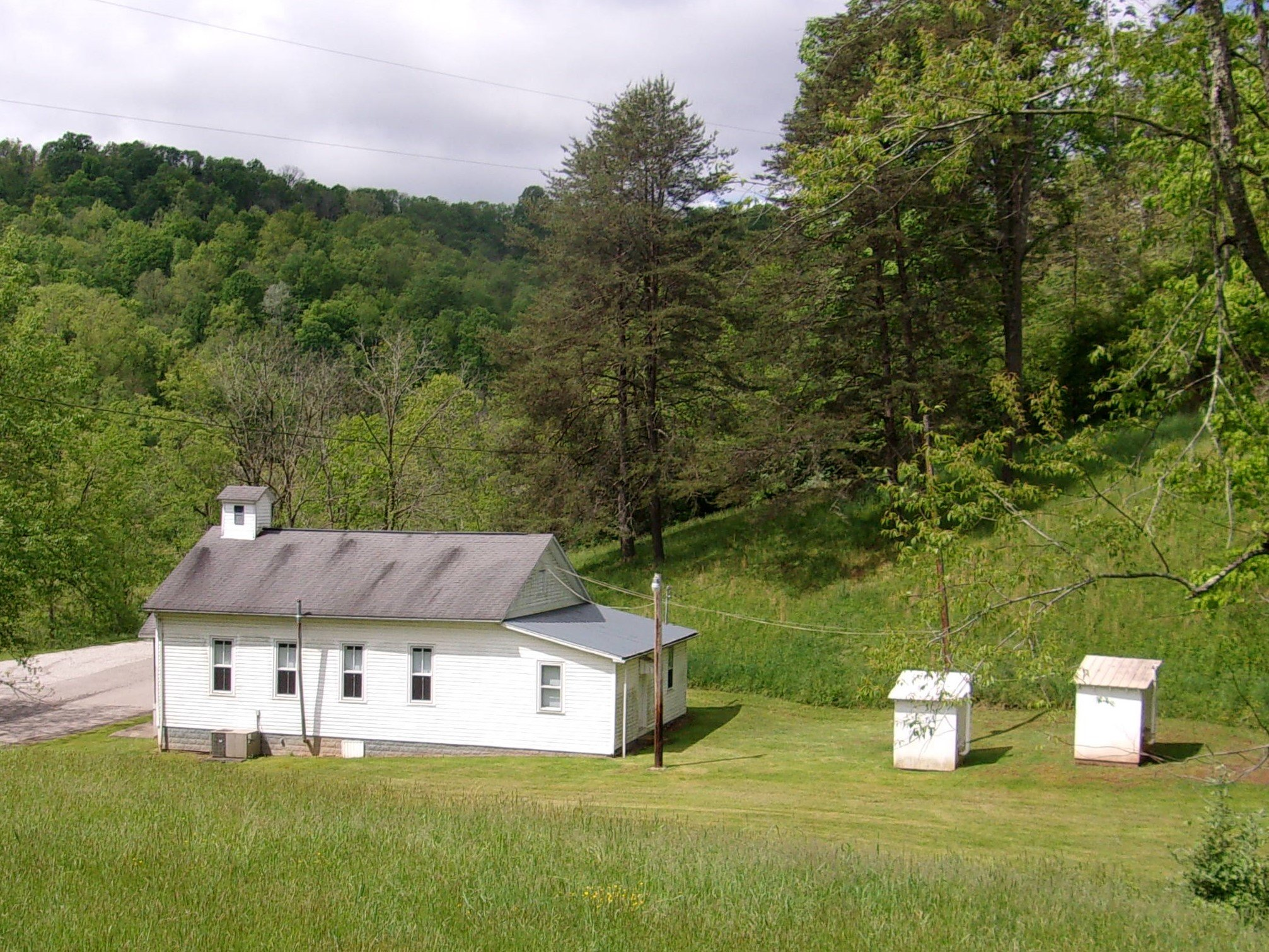 Dale Church of Christ as it appears today. Privies still in use as there is no indoor plumbing.