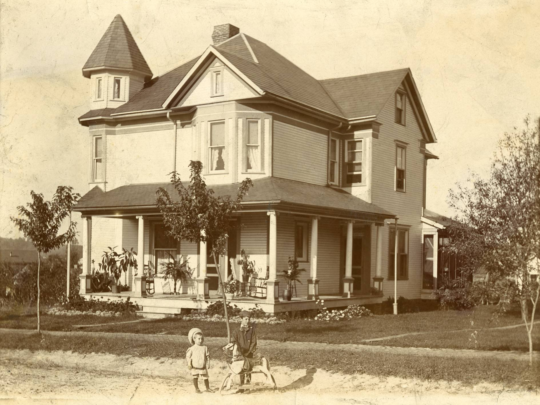 The J.E. Sellers house on East Street, Middlebourne, as it appeared in its heyday. Pictured are Robert and Russell Sellers, sons of the original owner. Photo courtesy of Rhonda Sellers Baro.