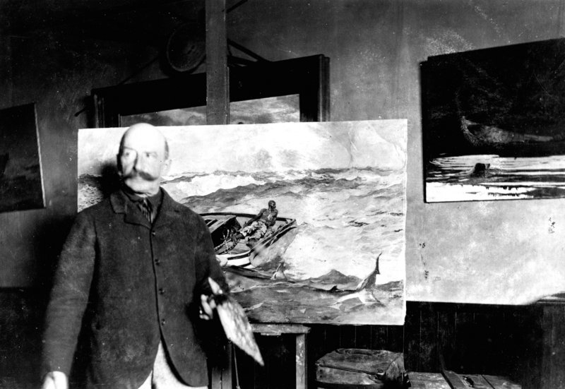 Winslow Homer standing in front of one of his paintings.