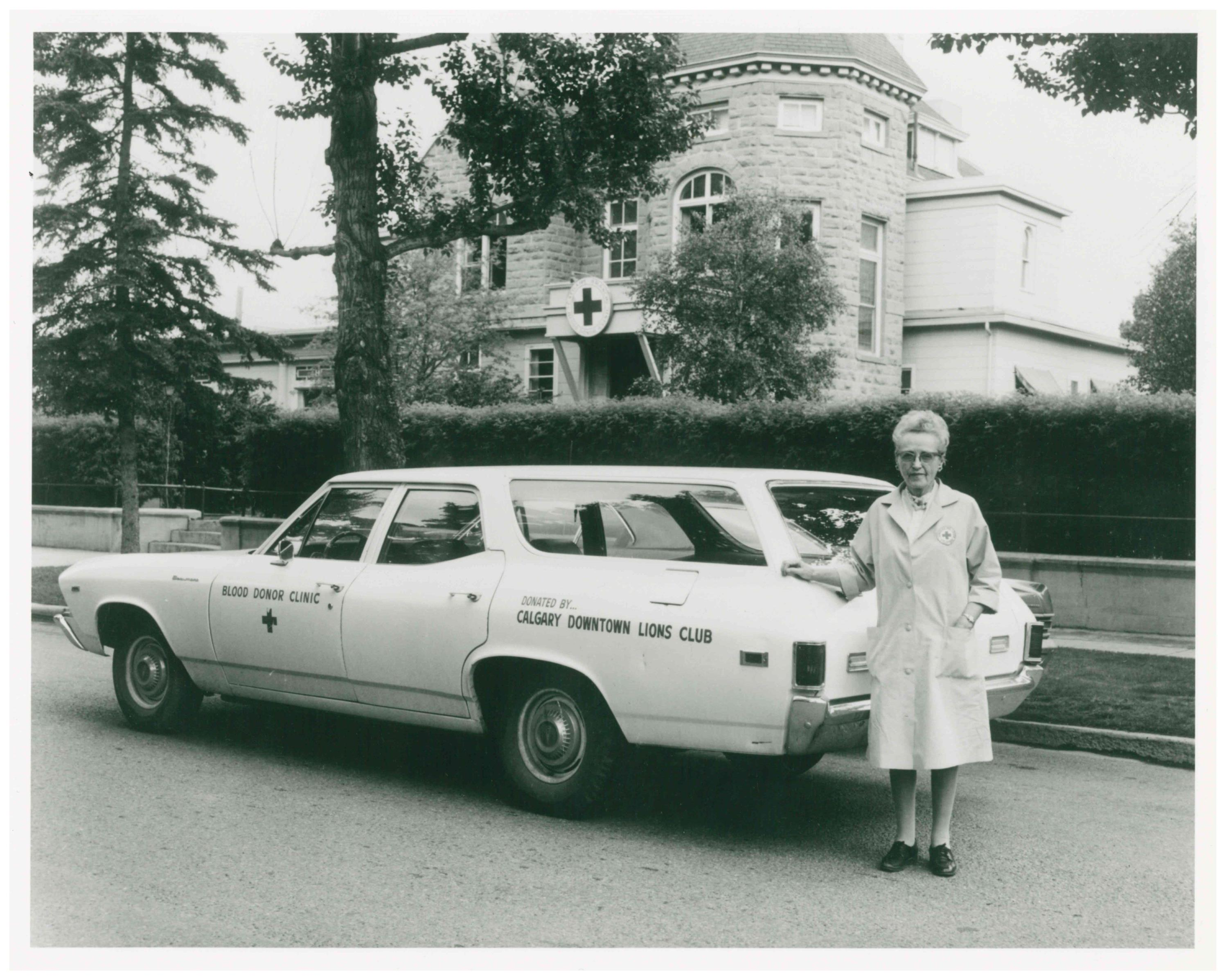 Mrs. T.L. O'Keefe in front of Blood donor clinic, Calgary