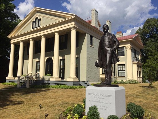 A Statue of Theodore Roosevelt Stands In Front of the Historic Home