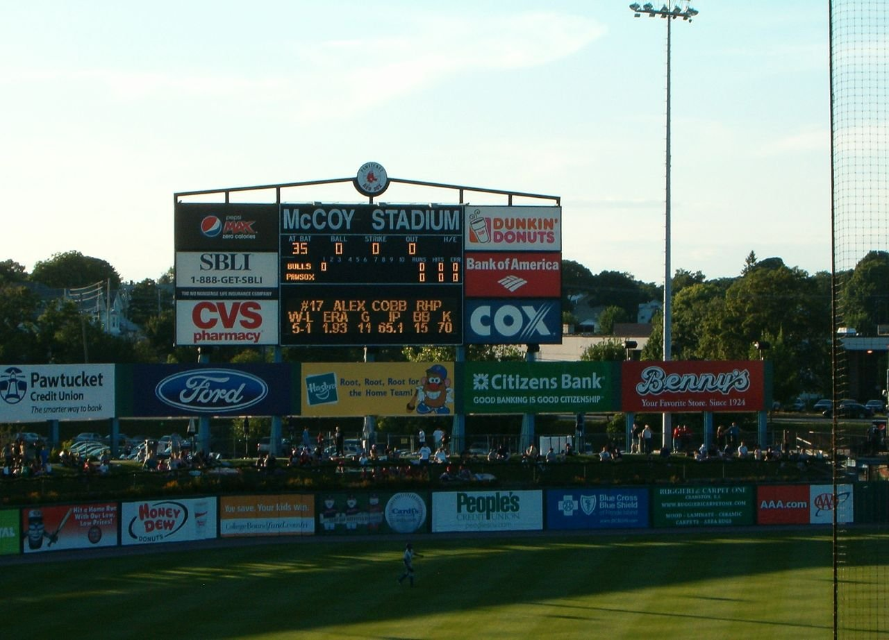The scoreboard and left field wall.