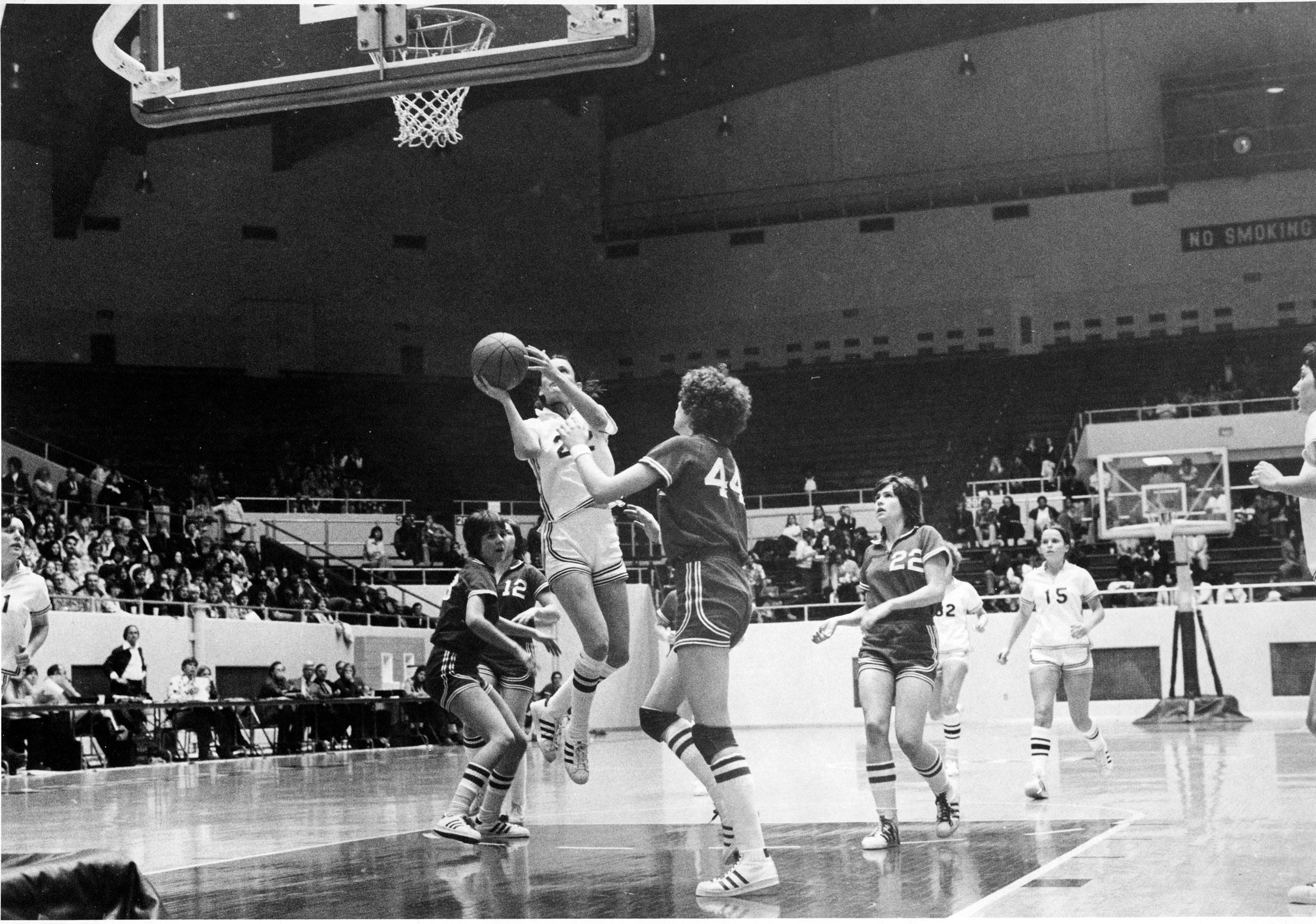 The women's basketball team playing a game in the Alumni Coliseum, ca. 1976.