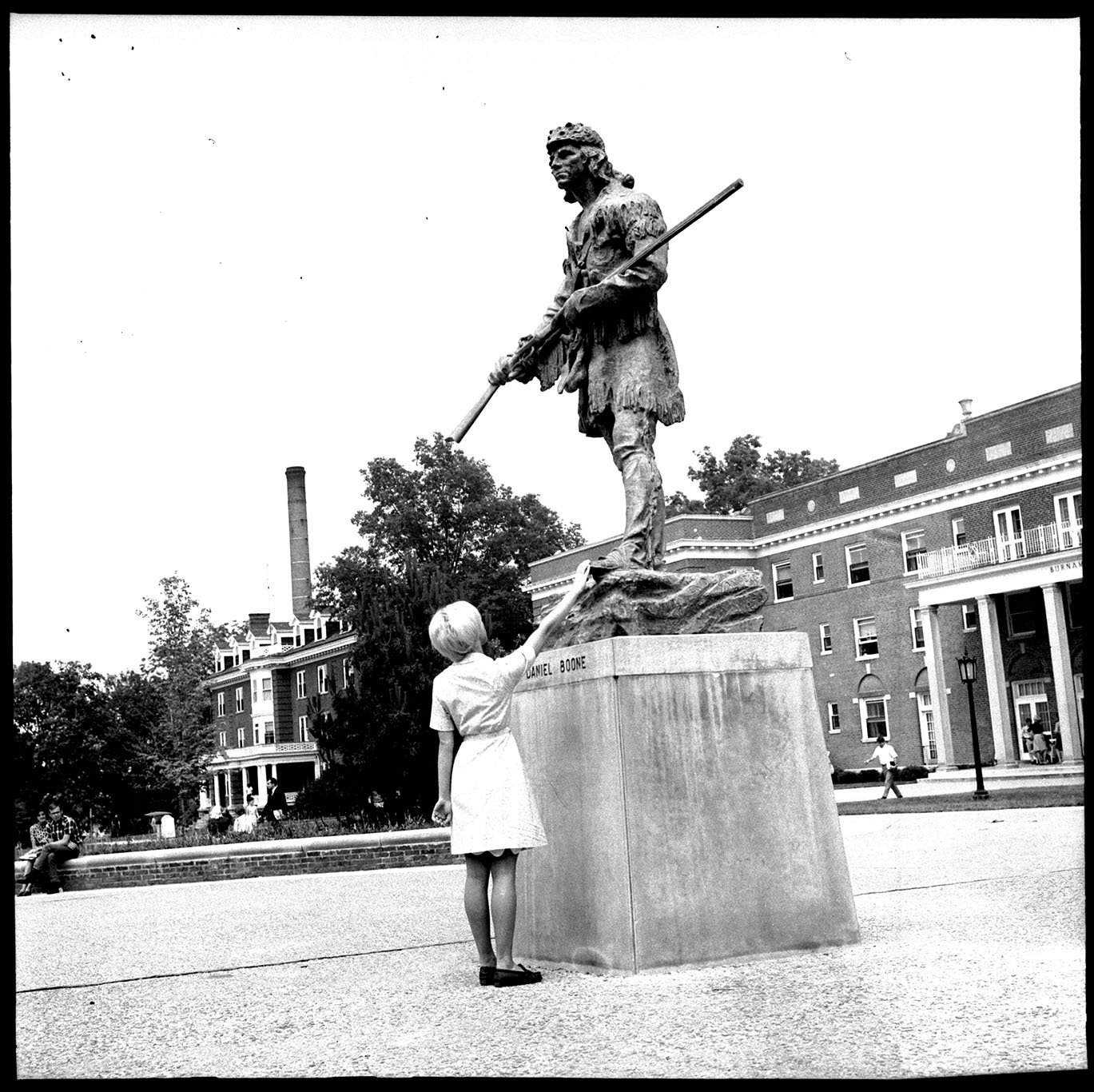 Rubbing the Daniel Boone statue's toe for good luck, 1967. EKU Negative Collection.