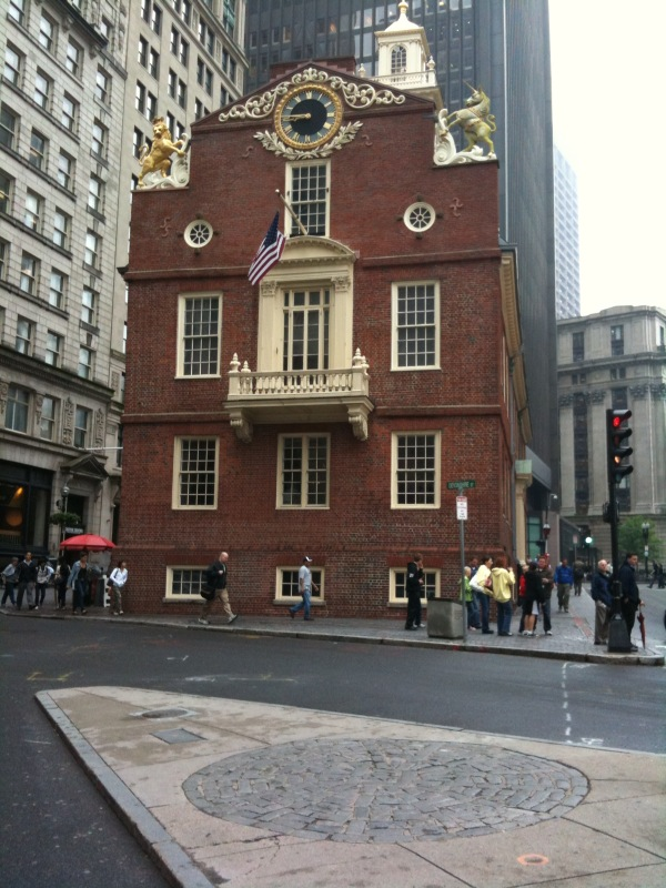 A circle of cobblestones in front of the Old State House marks the location of the Boston Massacre