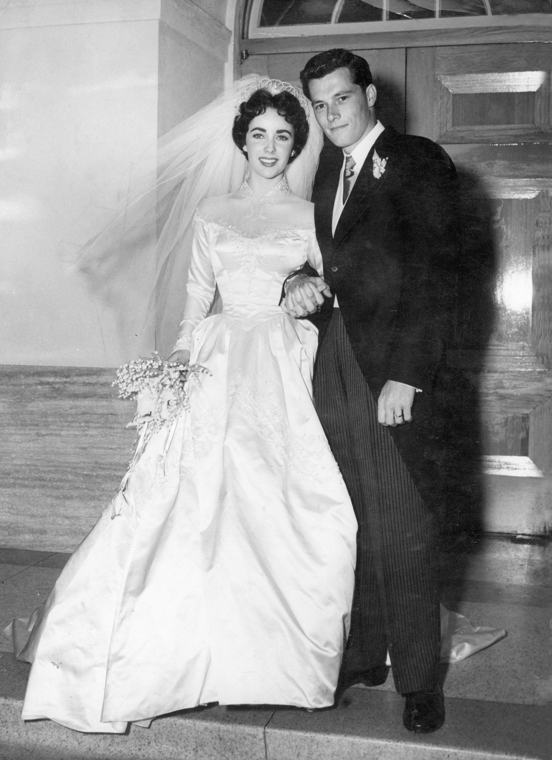 Elizabeth Taylor and Conrad Hilton, Jr. after their wedding at Church of The Good Shepherd on May 6, 1950