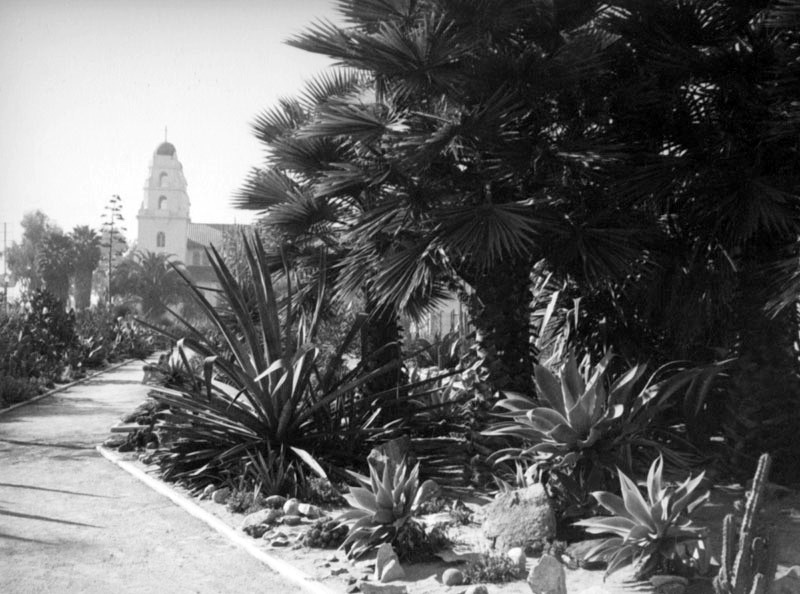 Photograph from the 1930s of Beverly Gardens Park with Church of The Good Shepherd in the background