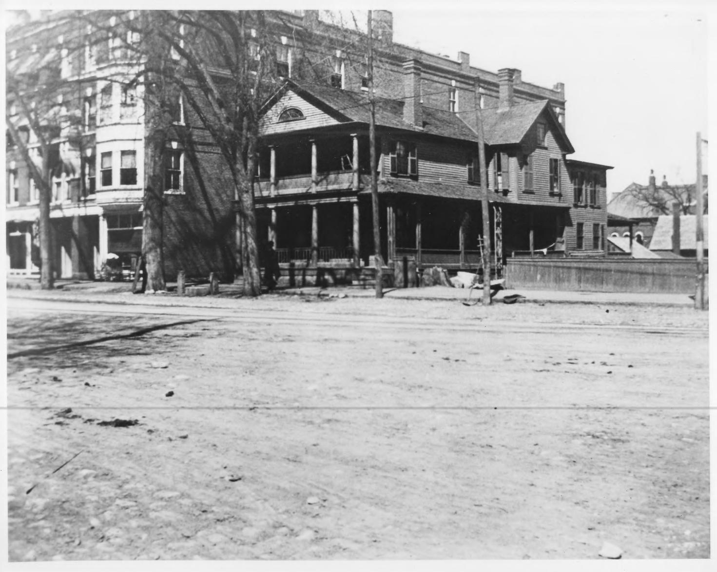 Endicott Hotel (Blanchard's Block) and nearby house, demonstrating how the Endicott arose as the first commercial building on that section of Main Street in 1894.