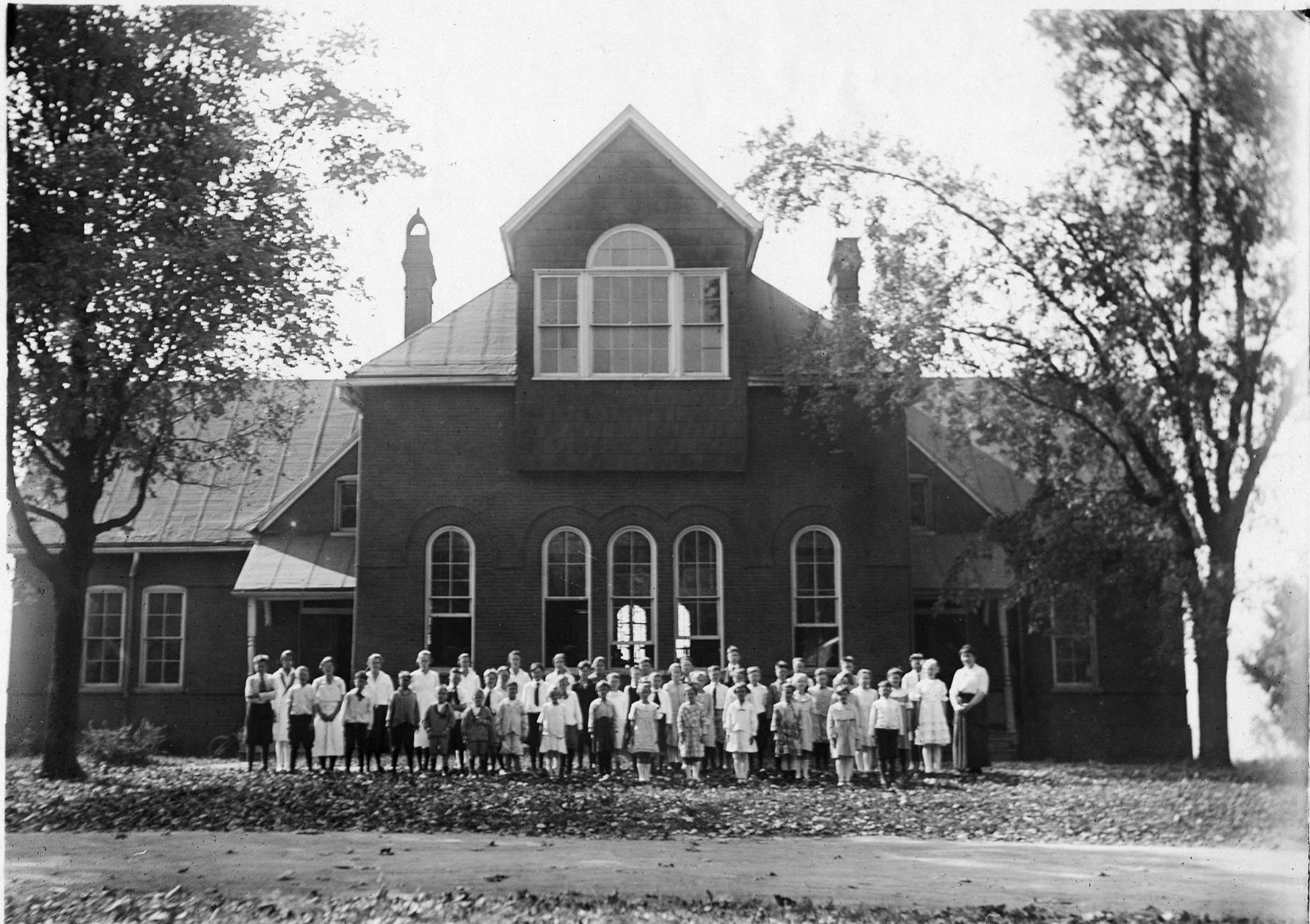 Central University Preparatory School Building with students in the front yard, 1920s. EKU Photo Collection.