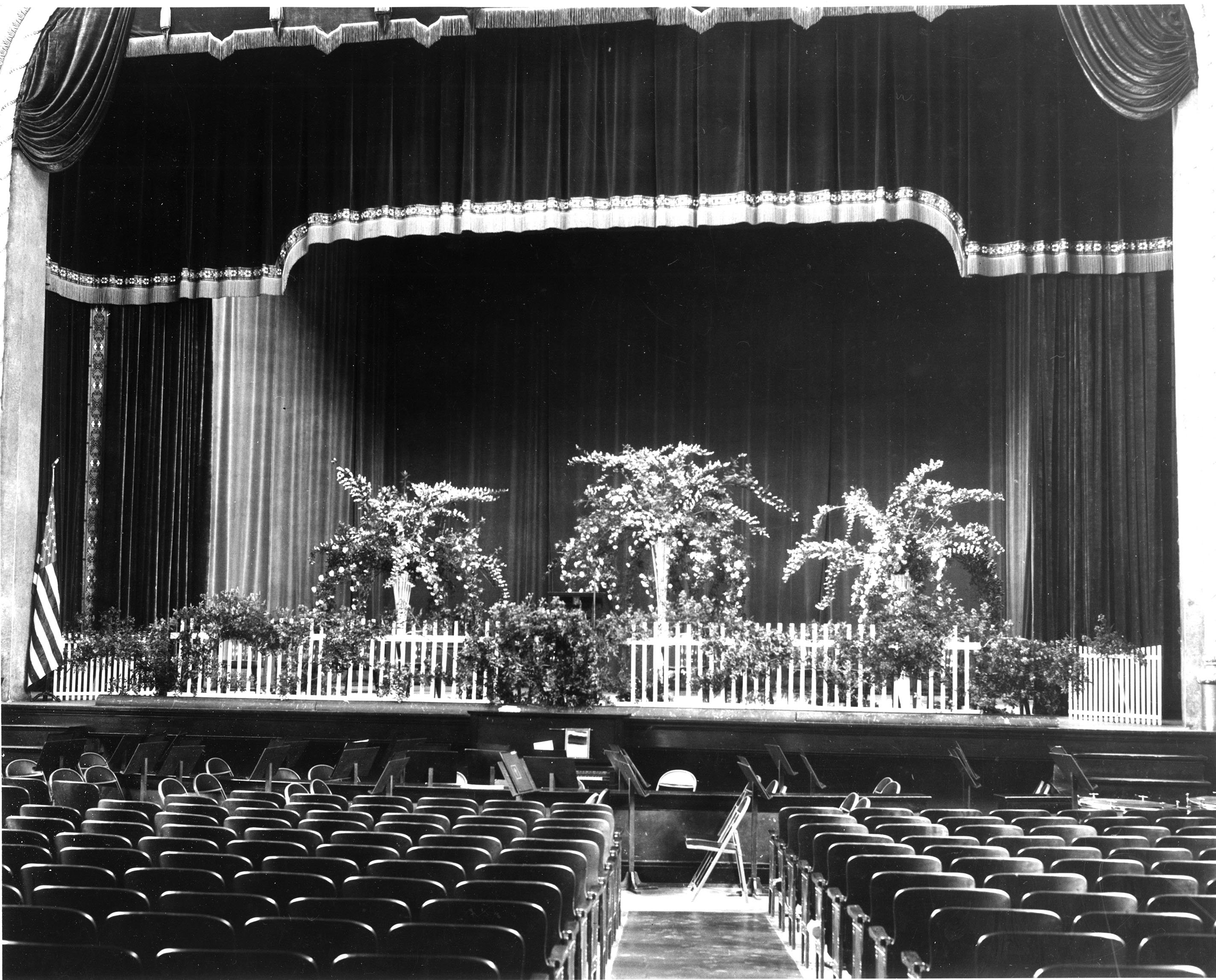 Stage decorated for commencement, ca. 1938. EKU Photograph Collection.