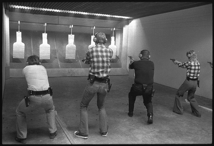 Students practicing on the firing range in the Robert R. Martin Law Enforcement Center, 1976. EKU Negative Collection
