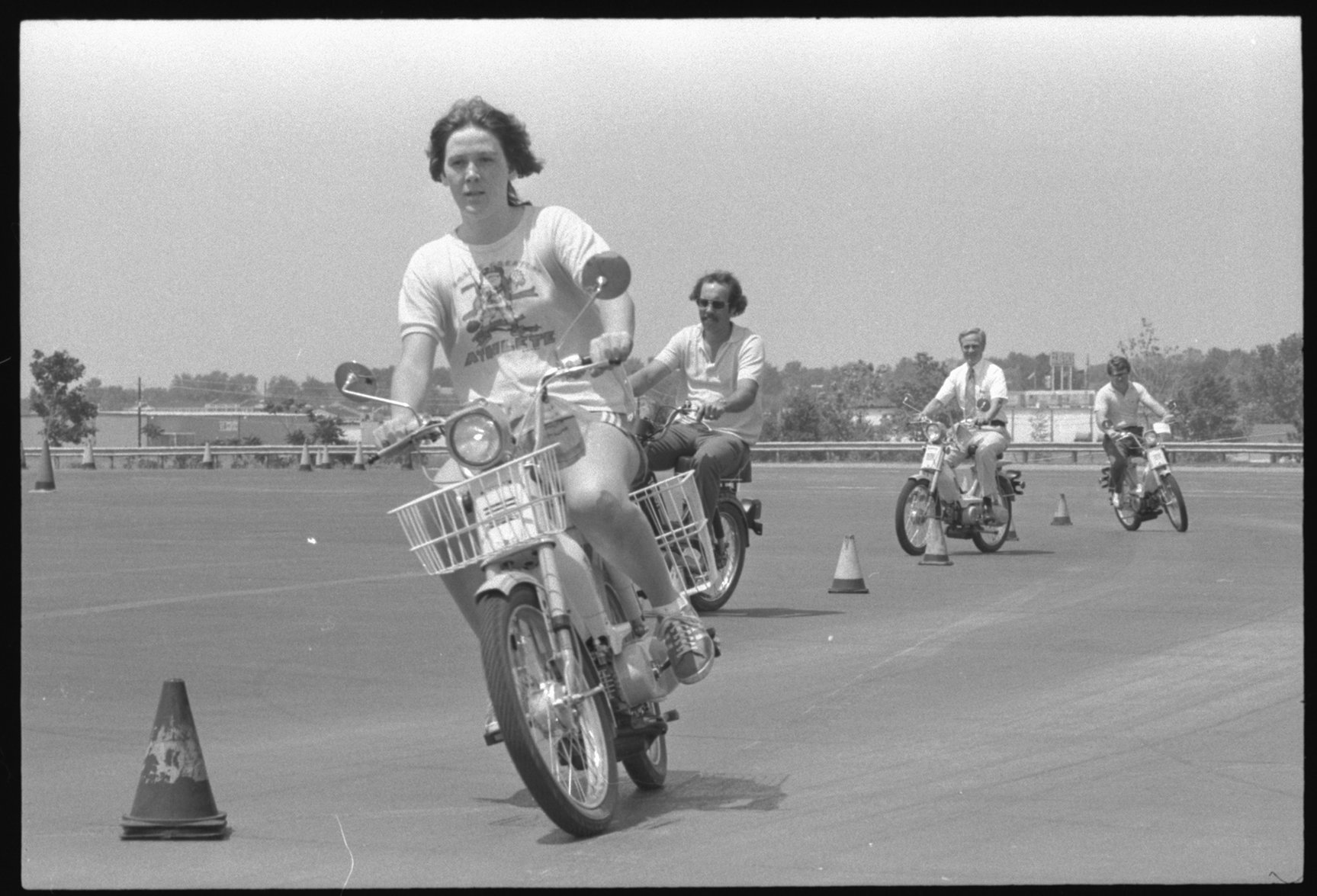 A moped clinic organized by the Traffic Safety Institute on the Leslie Leach Driving Range, 1978. EKU Negative Collection