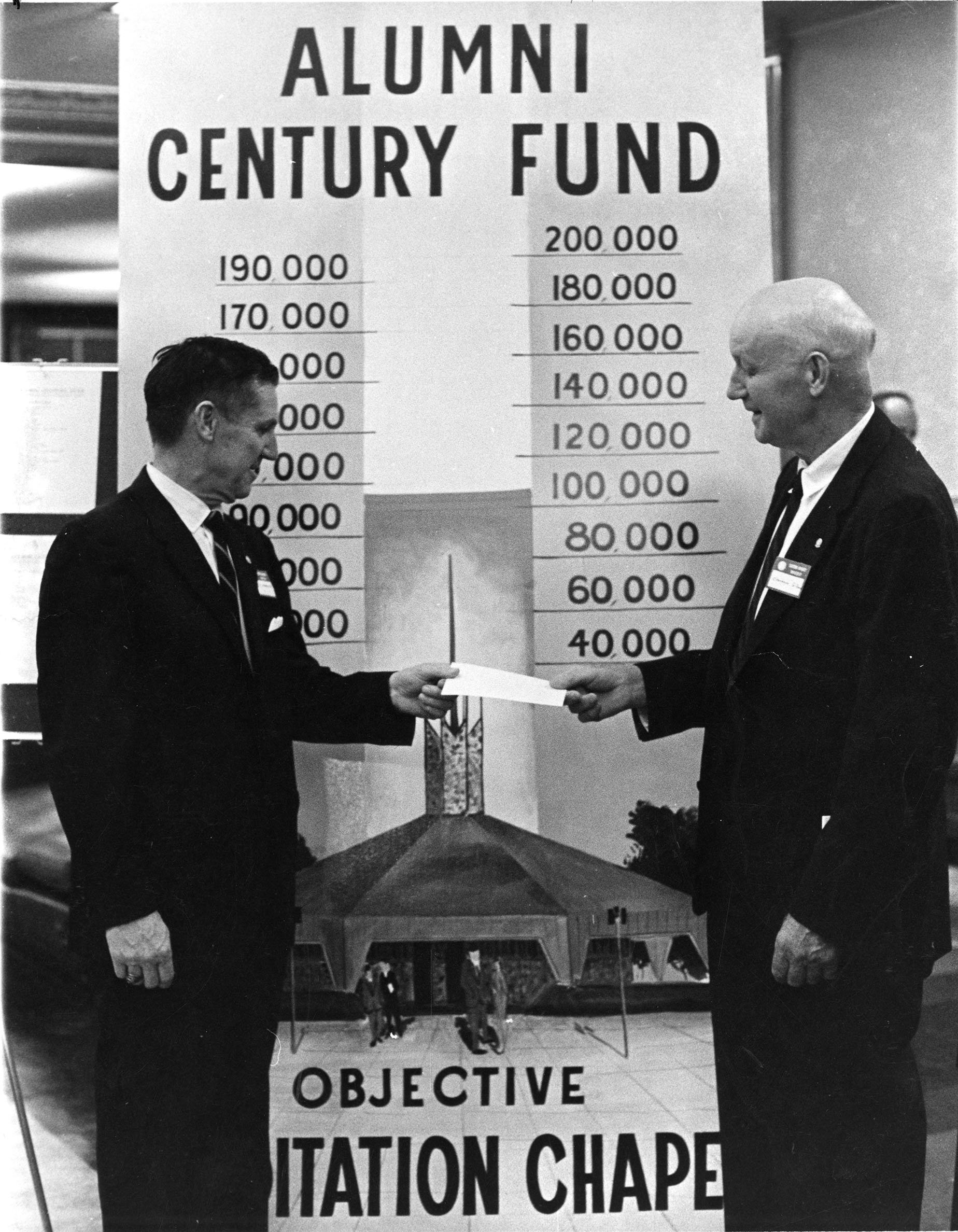 Clarence Gifford presents James W. Thurman a pledge on behalf of the Class of 1909 for the construction of the Meditation Chapel, 1968.  EKU Photo Collection.