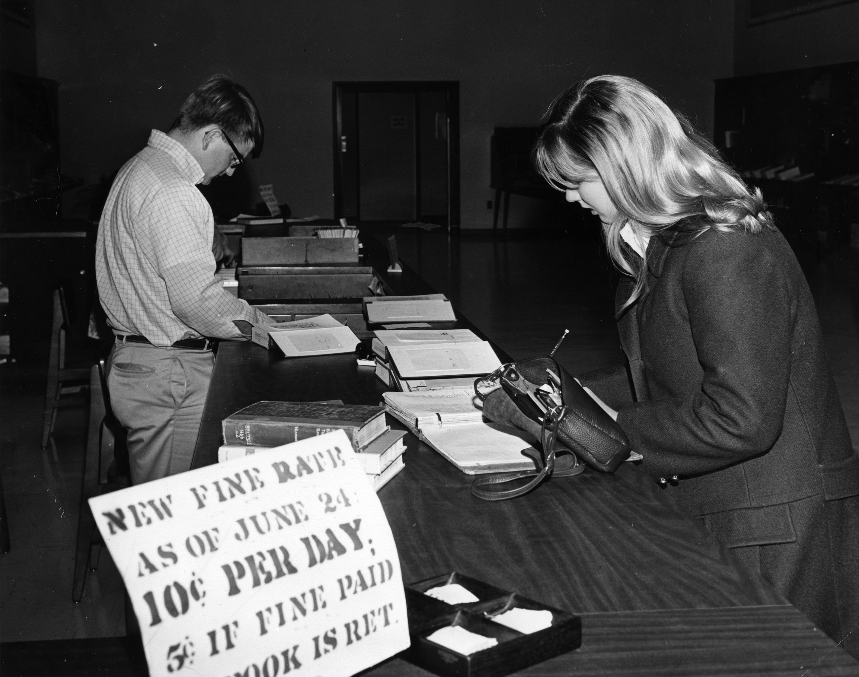 Woman paying a parking ticket, 1969.  EKU Photograph Collection.