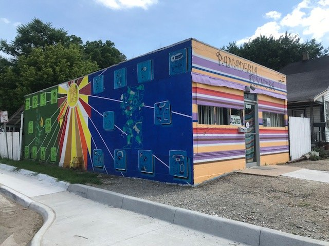 A colorful Mexican-American themed mural shares its location with the famous Panaderia Reynolds.