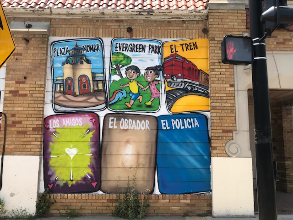 Across the street from the NoMar International Market there is a mural spearheaded by Armando Minjarez and other volunteers. the mural depicts issues the community is concerned with especially police abuse and topics such as Santa Fe railroads.