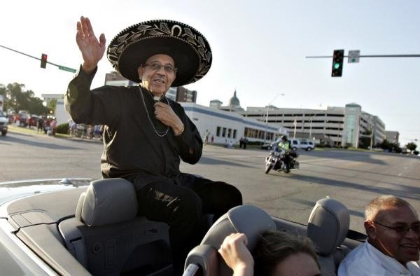 Father Gaitan in parade