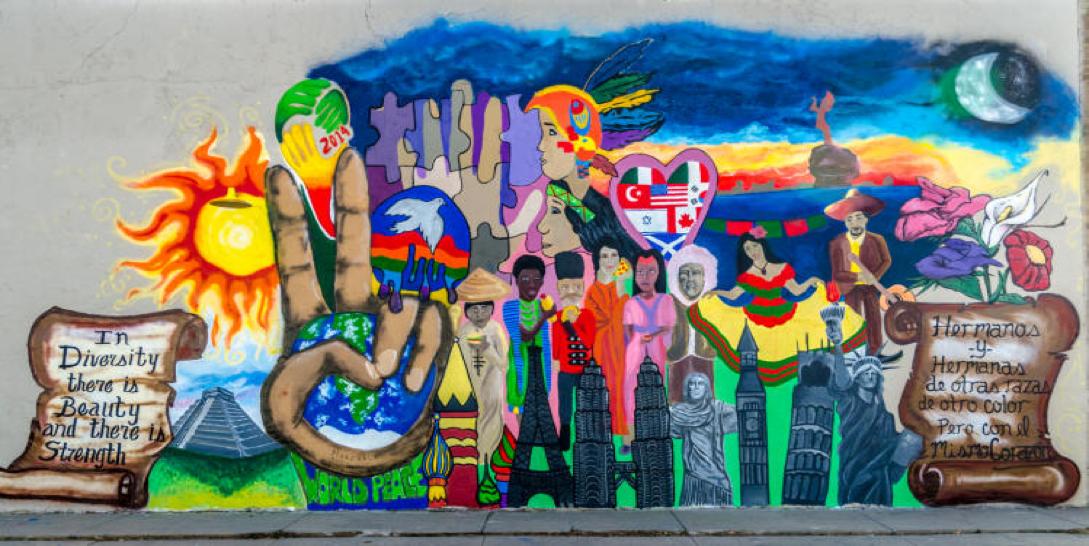 """""""In Diversity there is Beauty and there is Strength/Hermanos y hermanas de otras razas de color pero con el mismo corazón"""" Immigration is Beautiful Mural"""