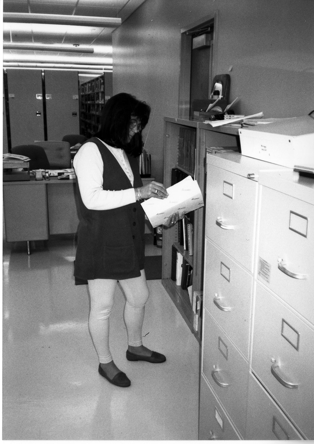 Archives assistant Trisha Henson looking through a file, 1996.  EKU Photo Collection.