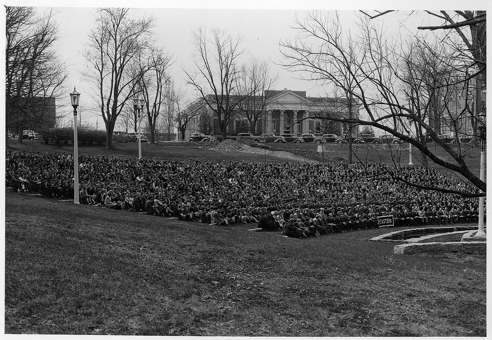 The entire student body and faculty sitting in the Ravine, 1939.  EKU Photo Collection.