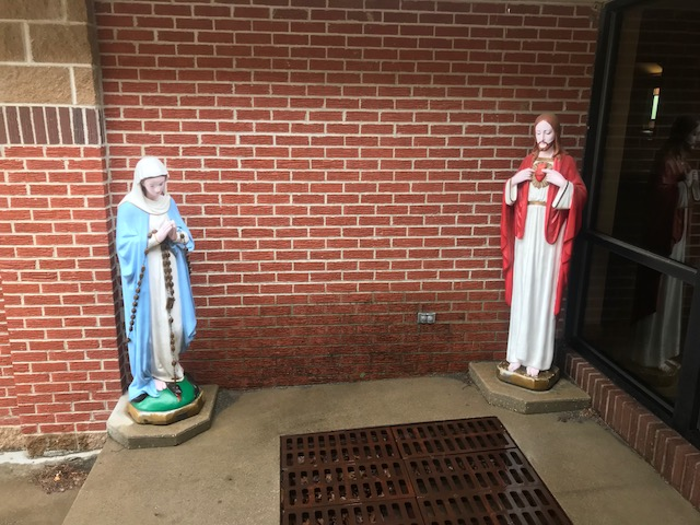 Jesus Christ and Virgin Mary located near The entrance