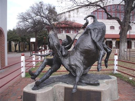 """The statue of Bill Pickett """"bulldogging"""" a steer."""