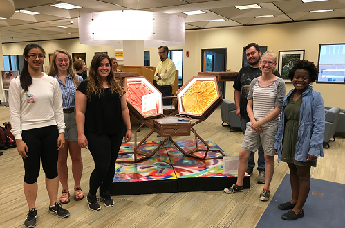 "2018 CESTA members pose with their completed installation, ""Cytochrome C"" in Evansdale Library"
