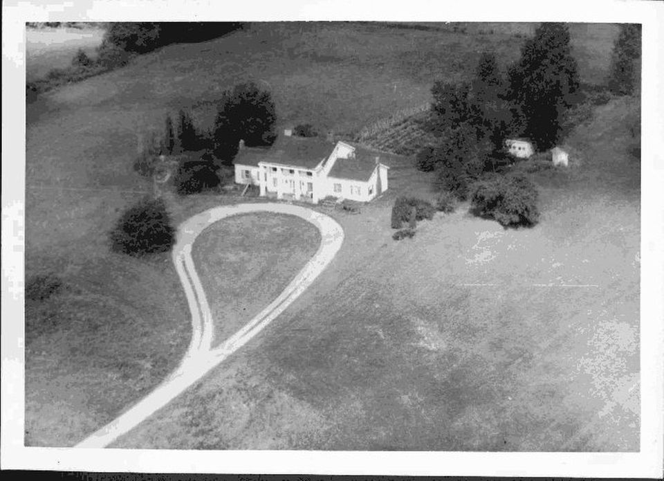 This is an aerial view of the house built by Frederick Hewitt who bought the tavern property in 1922. The house now serves as the visitor center for the historic site. Credit: Michigan Historical Center