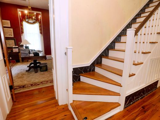 This staircase, moved from the back to a newer portion of the house, still displays a missing chunk on the bottom right step from when Harriet Arnold reportedly threw a hatchet at an unwelcome Union soldier. Image obtained from the Daily News Journal.
