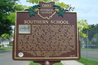 A marker in the Southern Playground detailing the history of the school.
