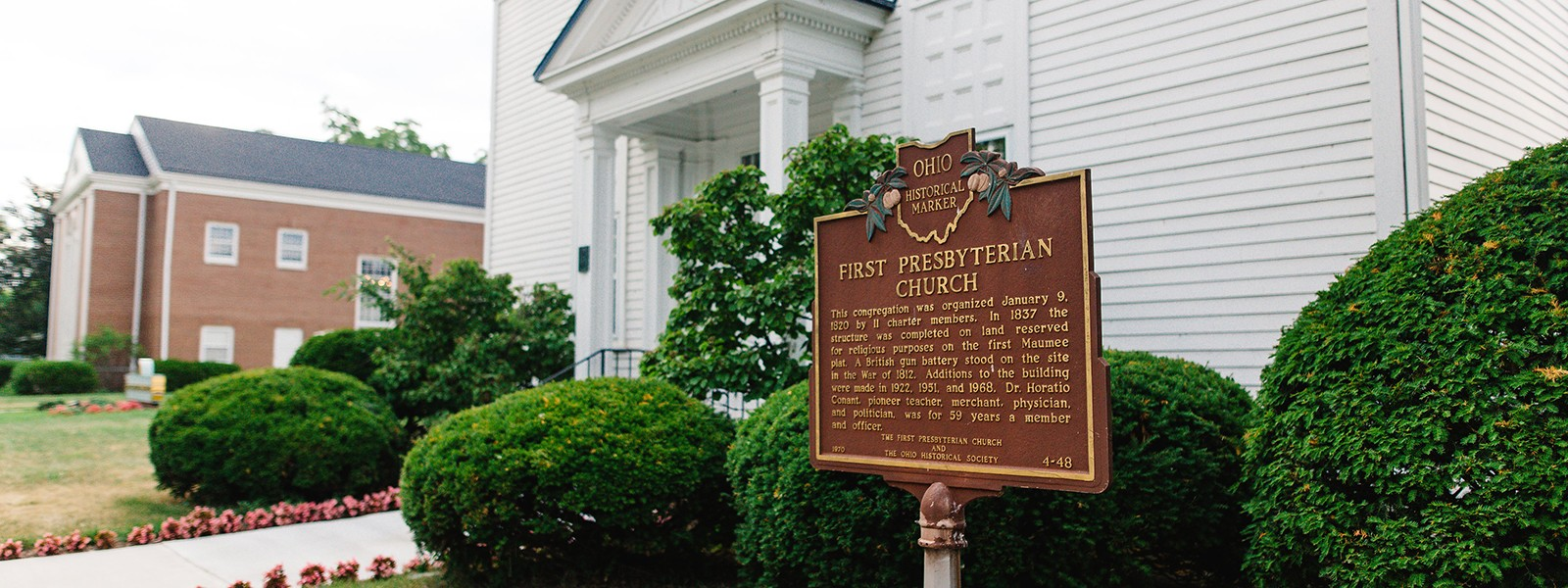 A historical marker in front of the church.
