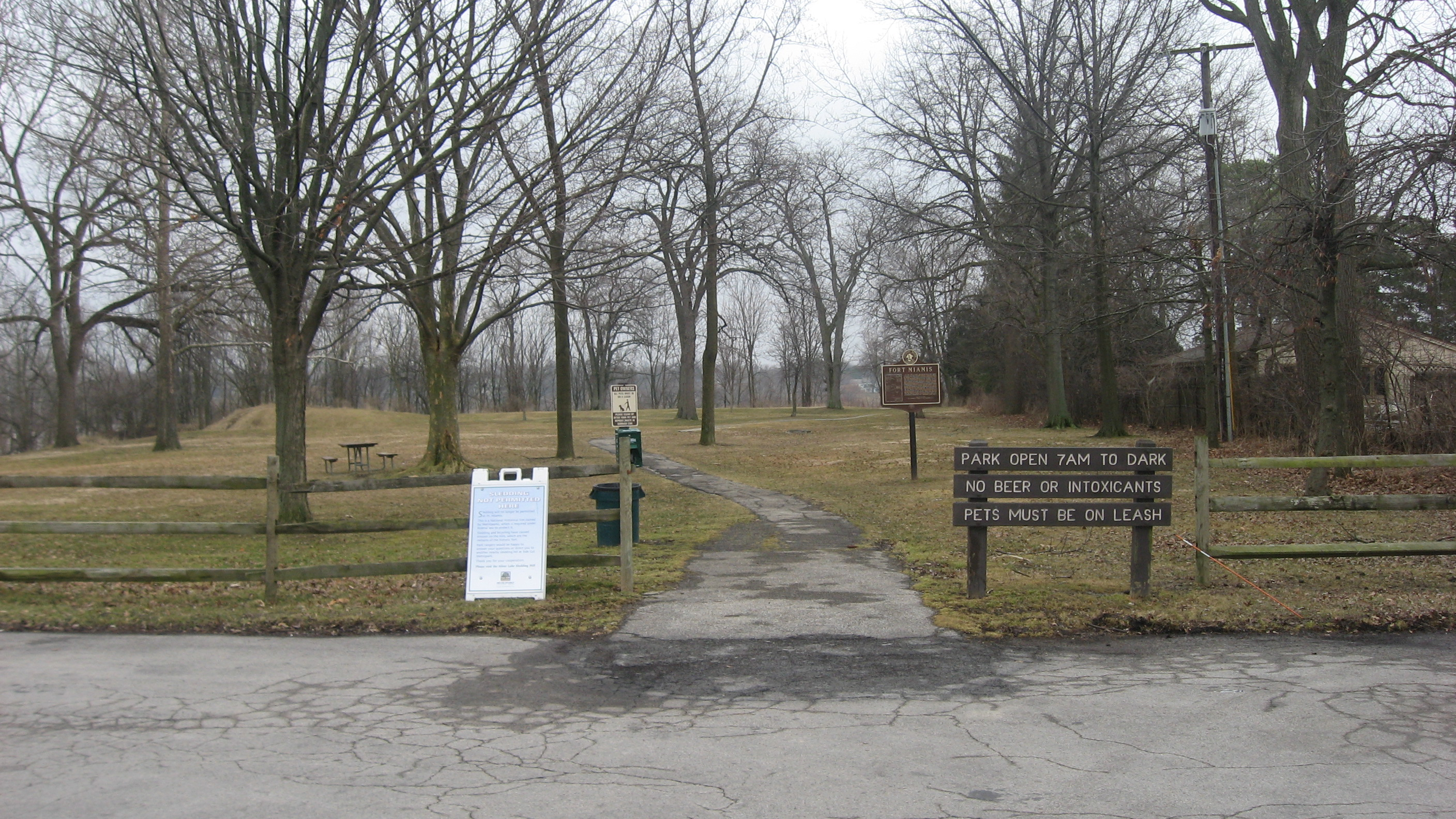 A wide shot of the marker in the park.