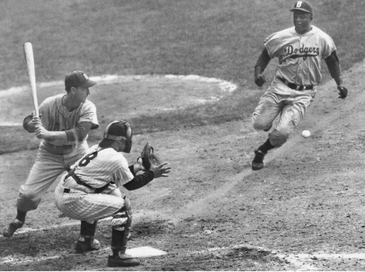 Robinson stealing home in the 1955 World Series. The intensity the Jackie played with garnered the respect of players around the league.