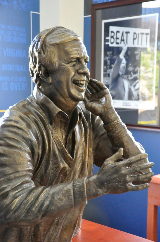 Fleming's statue is surrounded by inscriptions of his most famous quotes, and images and artifacts from his time as a broadcaster.