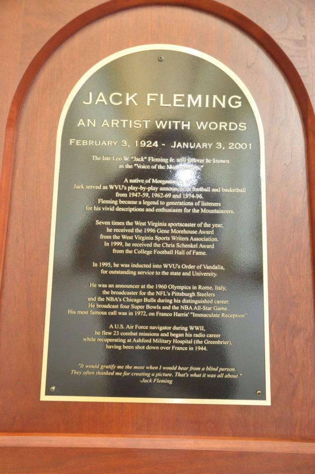 """A plaque displayed at the Fleming Corner, honoring the famous announcer """"an artist with words."""""""