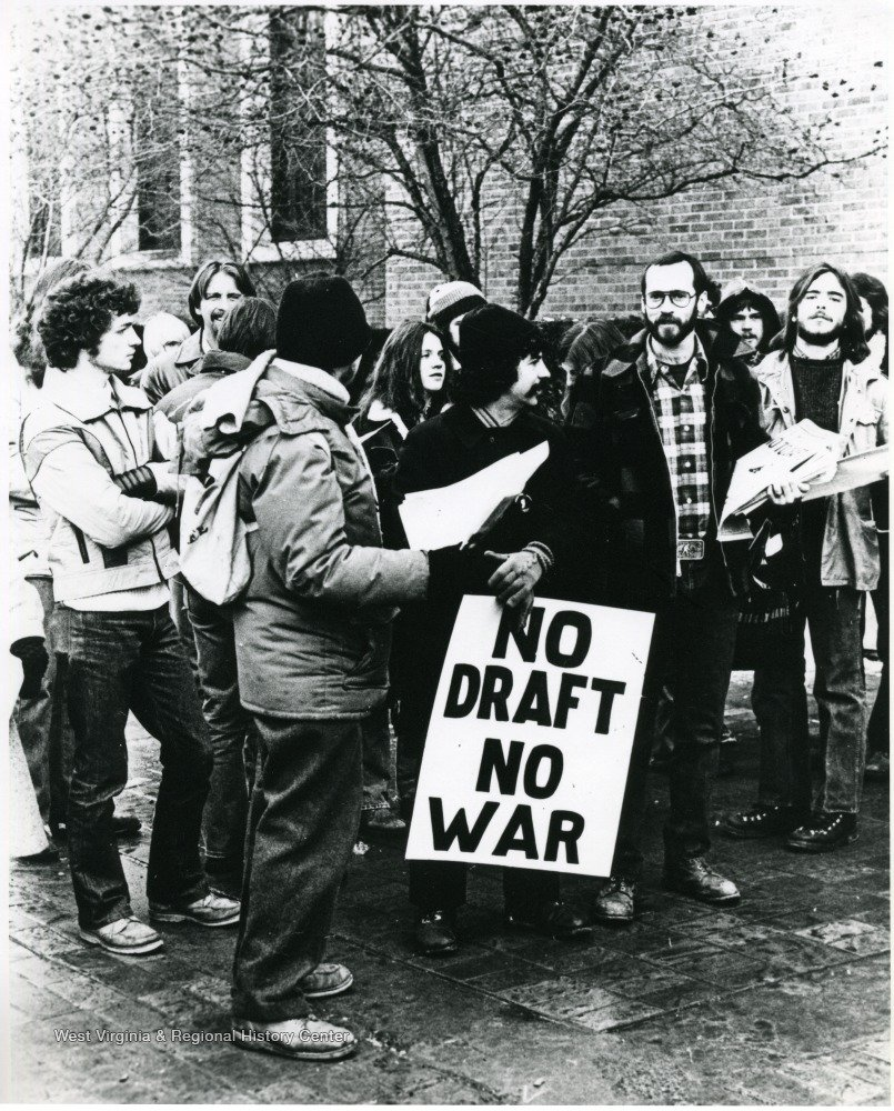 The front of the Mountainlair has long been a site for civic and political activism, like these students protesting the draft in 1980. West Virginia and Regional History Center, WVU Libraries.