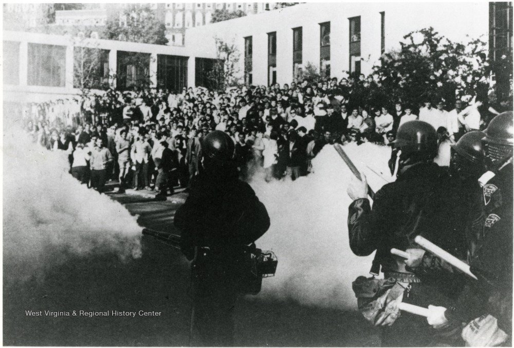 The biggest WVU student protest in the Vietnam era took place in front of the Mountainlair in May 1970, shortly after the bombing of Cambodia and Kent State shootings. Here, the National Guard sprays the raucous crowd with teargas. WVU Libraries.