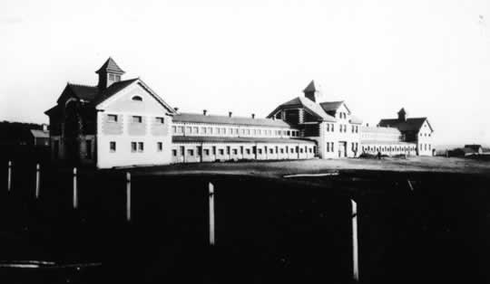 "This is the O.C. Barber Piggery as seen from Robinson Ave. This lavish barn, nicknamed the ""Pork Palace"" was the last major barn completed on the Anna Dean Farm."