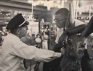 Security guard Frank Collins confronts NAG protester Marvis Saunders, National Park Service Glen Echo Park Photo Archives (reproduced under Fair Use)