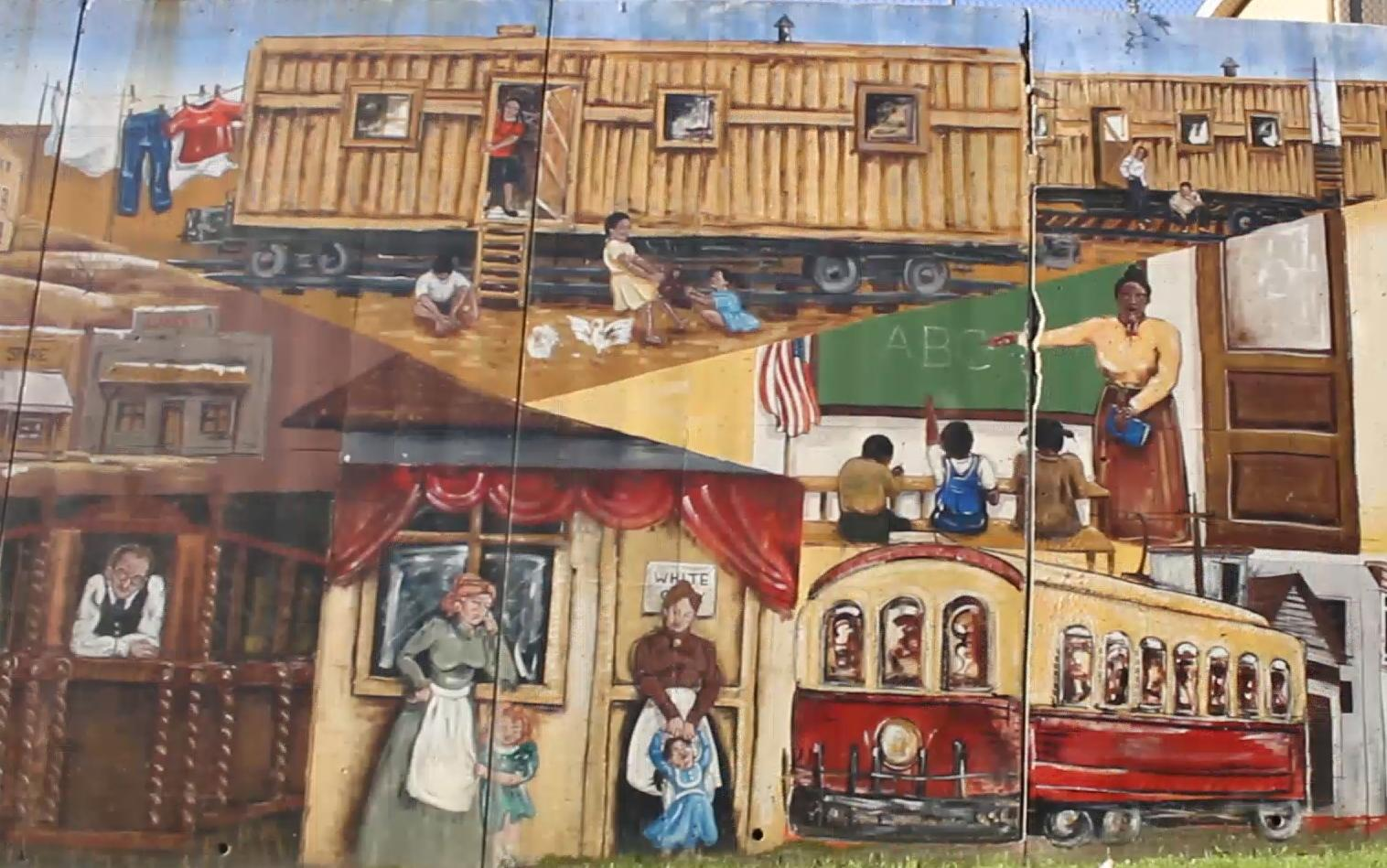 A mural in Argentine depicts Mexican railroad workers living in the boxcars that brought them to Argentine