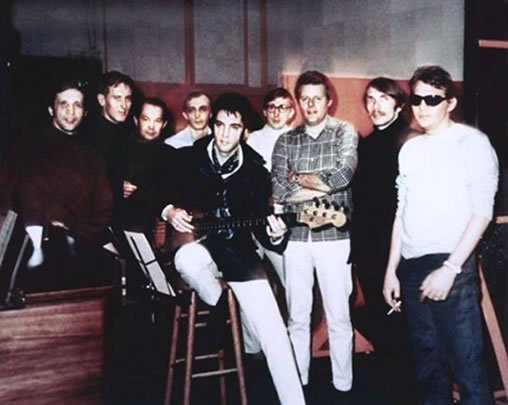 Elvis Presley with the house band for the American Sound Studio.