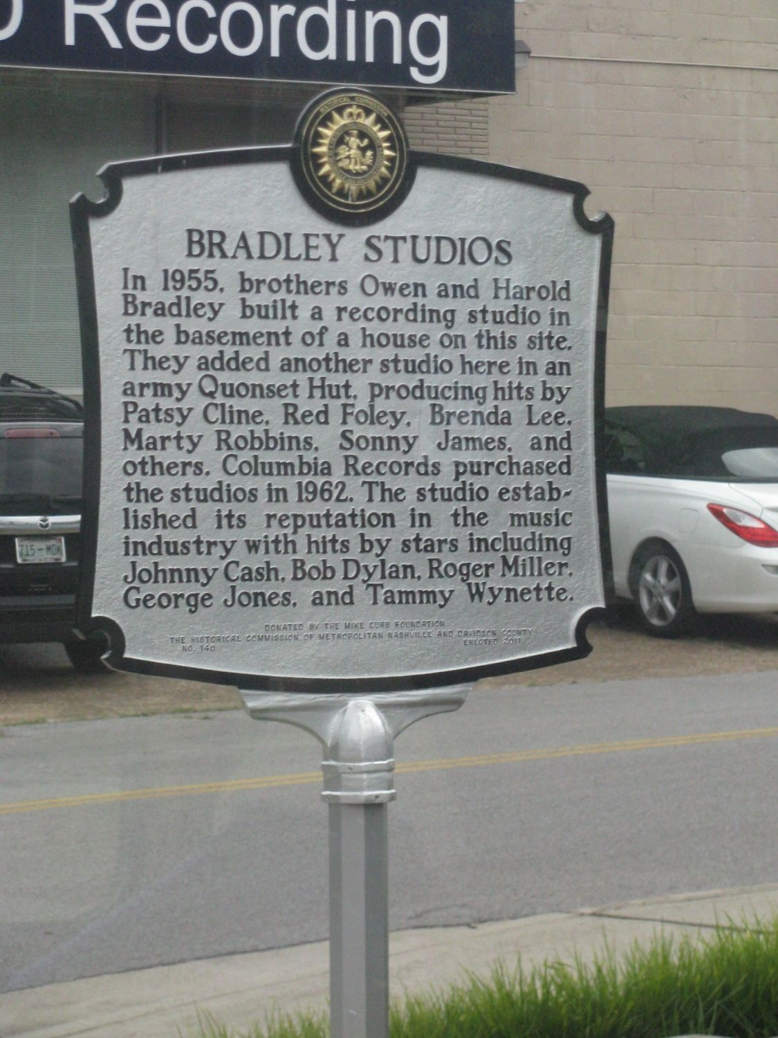 A historical marker near the site commemorates its role as the first music recording studio on Music Role. Image obtained from the Historical Marker Database.